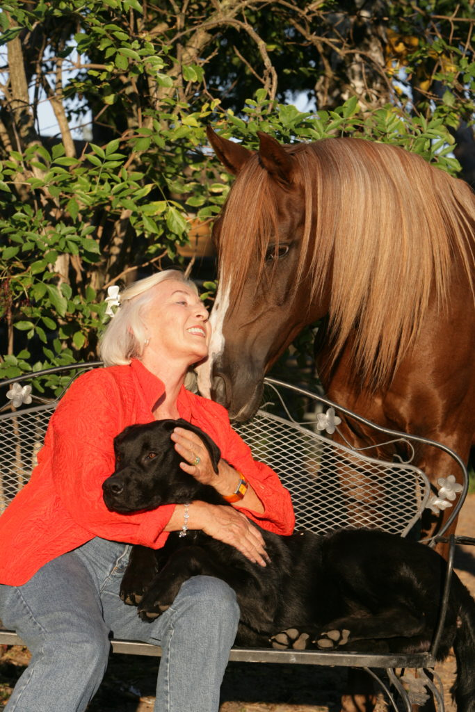 Linda Tellington Jones with horse and dog